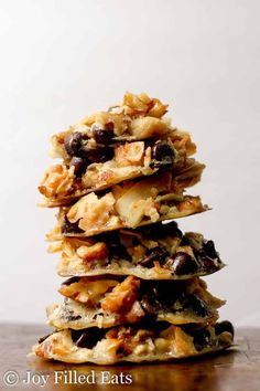 A tall stack of 6 magic cookies against a white background.