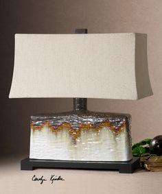 Необычная керамическая настольная лампа от производителя Uttermost.  •Выполнена в отделке ivory с темно-бронзовыми и оранжевыми каплями. •Лампа рассчитана на 100W.             Материал: Металл, Ткань, Керамика.              Бренд: Uttermost.              Стили: Классика и неоклассика, Лофт.              Цвета: Бежевый, Белый, Коричневый, Темно-коричневый.