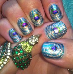 Peacock nail art by amanda04.deviantart.com
