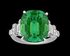 Tourmaline Ring by Raymond Yard, 9.88 Carats~ This captivating green tourmaline and diamond ring was crafted by American jeweler and designer Raymond Yard. Absolutely brilliant with an attractive and incredibly vibrant green hue, this stone represents the tourmaline at its very best, with a rich coloration that sets it apart from other green gemstones such as the emerald and peridot. ~M.S. Rau Antiques For Sale, Selling Antiques, Rare Gemstones, Green Gemstones, Tourmaline Ring, Green Tourmaline, Diamond Gemstone, Peridot, Diamond Engagement Rings