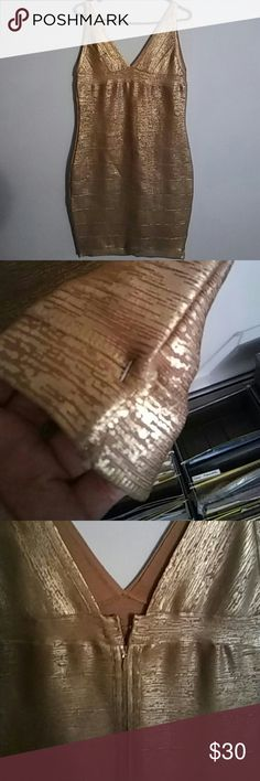 Cute Gold bandage dress Re-posh. Safety pin at end of dress picture. I never wore it. My lost your gain! venus Dresses