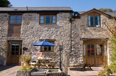 A traditional barn conversion cottage in Cornwall, Newlyn boasts an open plan living style split over two levels with two doubles and a twin bedroom Cornwall Cottages, Seaside Village, Falmouth, Breath Of Fresh Air, Living Styles, Open Plan Living, Country, House Styles, Holiday