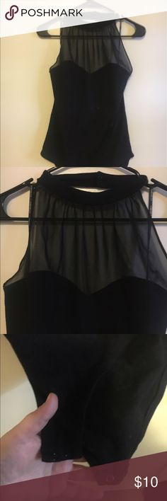 Black Halter Top Bodysuit w/ sheer black neckline Amazing body suit that can be dressed up or down and even worn with a blazer for a professional look. It has been work once and has no songs of wear. The halter top has a clasp closure same as the crotch area. It falls beautifully and creates an amazing neckline so you will not even need a necklace. All offers welcome. Forever 21 Tops