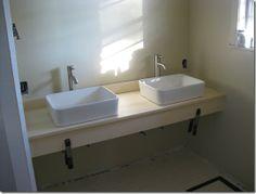 DIY floating bathroom vanity.. wood stained