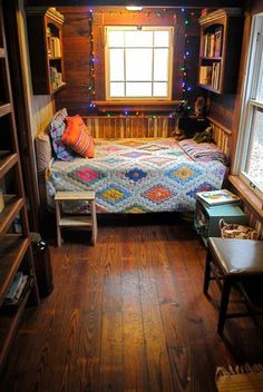 Loooove the idea of a room that's pretty much just a little bed nook for the kiddos (and for us adults).