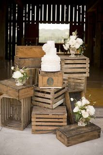 Idea for gift table, just random things stacked with the card mailbox in the middle? The French Flea: Rustic Vintage Furniture and Decor for my First Barn Wedding!