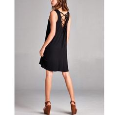 Free Shipping! Lace Back Loose Black Dress NWT Flirty Lace Back Loose fitting April Spirit Dress in Black.  Small, Medium, & Large available!!  95% Rayon 5% Spandex. Free Shipping April Spirit Dresses Mini