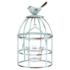 Weathered candleholder with a bird finial.   Product: CandleholderConstruction Material: Metal and glassCo...