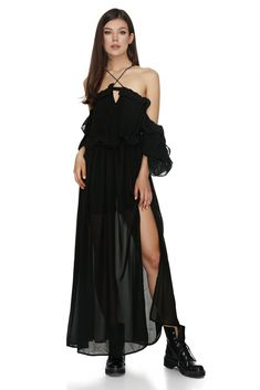 With a dramatic off-the-shoulder neckline and a frontal V strap that goes on to reveal an open back, this Vero Milano black open shoulders ruffled dress offers a spectacular array of ruched ruffles for a playful effect. Comes with petticoat pants. Ruffle Dress, Ruffles, Off The Shoulder, Cold Shoulder Dress, Dresses Online, Designer Dresses, Summer Outfits, Feminine, Neckline