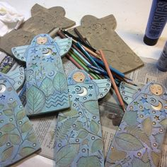 Sue Davis is painting her clay angels.