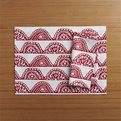 Strands of festive flags wave lacy red on white cotton table linens. 100% cottonMachine wash cold, dry low; warm iron as neededDo not dry clean or bleachMade in India.