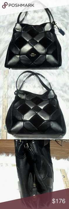 COACH BLACK LATTICE This extremely elegant coach black lattice style bag can speak for its self bound to turn heads on those crowded city streets and certainly set you apart from the rest only a few fetures might escape your eye but there are some things worth mentioning to a potential buyer this bag comes with its original like new dust jacket and also comes equipped with a zipper twist lock great for keeping unwanted vistors out of your beautiful new bag! Coach Bags Shoulder Bags