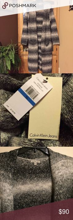 Calvin Klein long sweater Gorgeous 2 pocket long  Calvin Klein cardigan. This sweater can be dressed up or chic and casual with a top. jeans and a pair of your cutest boots. New with tags Calvin Klein Sweaters Cardigans