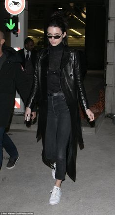Holy Trinity! Kendall Jenner touches down in Paris dressed like something from The Matrix ahead of another Fashion Week... following her weekend off in Amsterdam