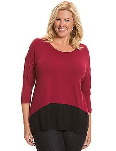 Soft scoop neck tee is a versatile must-have with modern colorblocking and a high-low hem. Short sleeves.   lanebryant.com