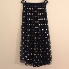 "HPVintage Paris Elegance design Yvette  Elegant black skirt with gold Mylar 1 inch dots  with black lining . It is 37 inches long. size 36 euro/ 8 U.S.the waist is a set in waist and measures 29.5"" with a Back zipper  Yvette  Dresses"