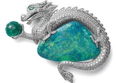 Cartier platinum brooch with one opal, one ribbed emerald, diamonds and eyes of emerald.