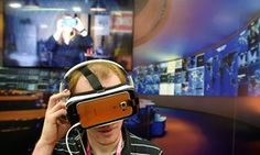 An attendee at Black Hat, a hacking and cyber security conference in Las Vegas, watches a virtual reality video.
