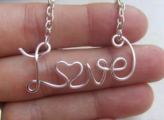 Love Necklace Personalized Name Necklace Silver Up to 8 Letters Wire Word Necklace Word Jewelry Wire Wrapped Grad Gifts Under 20. $16.95, via Etsy.