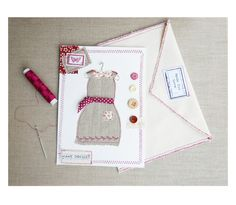 Card with linen dress, a nice card mixing paper and textile, linen dress and printed fabric, cut and sewn on the card, with an envelope in