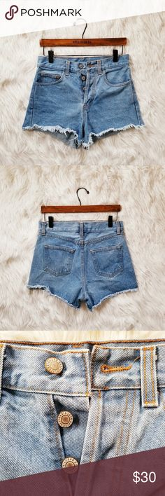 "Brandy Melville John Galt Denim Cut Off Shorts Medium wash. Good condition. No stains. Frayed hemline. Button front. Mid rise. 12.5"" waist to hem,  14"" waist. Brandy Melville Shorts"