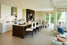 Love how fluid the seating area is to the kitchen.  What a great place to get a cup of hot chocolate and unwind.