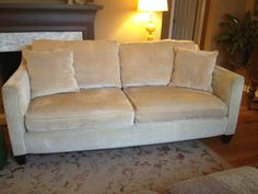 71 beige microfiber sofa. 4 years old and gently used. Nonsmoking house. Pet free after the first year. 71 wide, 39 deep and 32 tall. Comes with 2 throw pillows. Sofa is in very nice condition and...