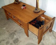 Coffee Table Hide-away, at least this one won't tip over from the weight of the guns when opened!