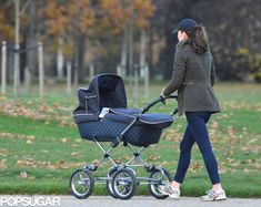 Duchess of Cambridge out with Prince George and dog Lupo for a stroll in Kensington Gardens, December 4, 2013