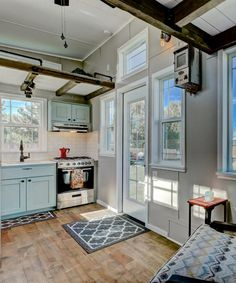 """This 22' custom tiny house on wheels features 5"""" hickory hardwood flooring.  Large windows throughout the house allow for ample natural light."""