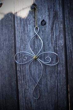 Well crafted Christmas Tree or Fleur-De-Lis wire ornaments are handmade to order with care and precision. Wire ornaments are made out of silver aluminum wire, and are approximately 4 inches in height. nomad blue nomadblue.shop nomadblue-shop