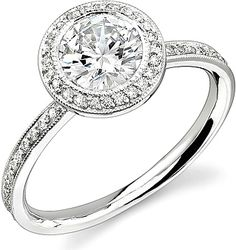 Stardust Bezel Set Diamond Engagement Ring w/ Round Halo .40cttw  : This beautiful engagement ring setting by Stardust features round brilliant cut diamonds  pave set throughout the band with a round halo that accent the center stone.