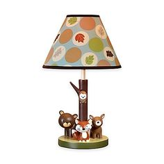 The Carter's Friends Collection Lamp and Shade features 4 forest creatures hanging out under a canopy of colorful leaves. The bear, fox, deer, and owl will keep adorable watch over your little one.