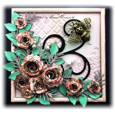 Decorated box using spellbinder spiral blossoms and foliage dies, large bee metal embellishment