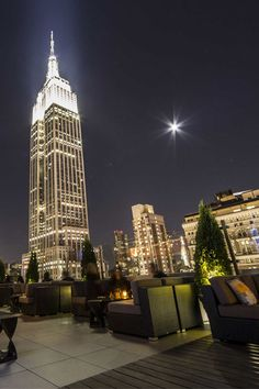 NYC. Manhattan rooftop bar at night with a star