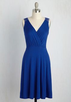 There's something about this cobalt dress that instills you with a sense of relaxation. Is it the way the sun hits the surplice neckline and crocheted back? Or, perhaps the way the sea-spritzed breeze moves its jersey-knit fabric? We have a feeling it's all of that and more!