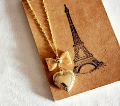 Gold bow and heart necklace.