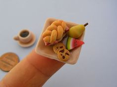 http://flavorwire.com/279758/adorable-tiny-food-sculptures-that-fit-on-the-tip-of-your-finger?all=1