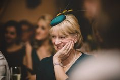 Beautiful Mother of the Bride in a teal silk button with grass