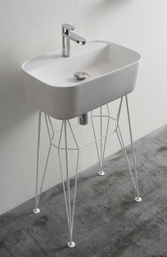 'gus' ceramic bathroom washbasin by michael hilgers