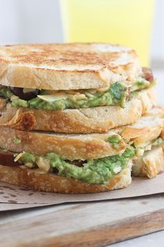 Kick off to Grilled Cheese Month - Chipotle Cheddar Grilled Cheese with spicy andouille sausage and salty smashed avocado.