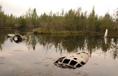 "The ""Lady of the Lake"" is the last WB-29 Superfortress left at Eielson Air Force Base in Alaska, which was dropped from the Air Force inventory in 1955 because of a ground accident. The aircraft was taken to the pond it currently rests in and was used for open water extracation training until it became too dangerous. The aircraft was abandoned where it lays. U.S. Air Force photo by Staff Sergeant Joshua Strang"