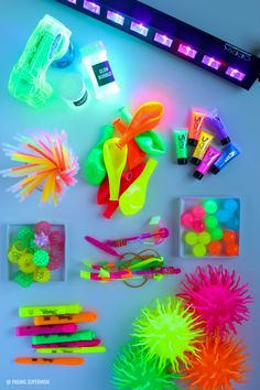 The ULTIMATE Blacklight Party Guide - glowing party ideas, glowing decor ideas, glowing food ideas, the BEST blacklight, and the coolest glow-in-the-dark party favors via @PagingSupermom