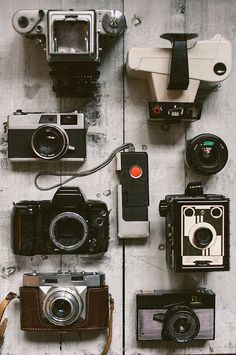 The Old Cameras on a White Board by Branislav Jovanović