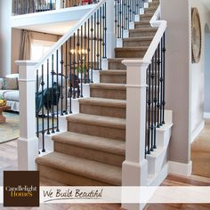 White wood railings and wrought iron spindles create the perfect contrast for…