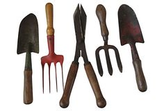 """Set of five English gardening implements. Still useful and make a wonderful display. Wood handles have nice patina. English impressed mark on some.Largest 14""""L x 5""""W; smallest, 10""""L x 3.25""""W."""