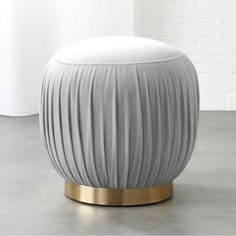 Designed by Euga Design Studio, rich velvet goes 360 with flirty folds as soft seating or stand-alone ottoman. Round brass base pulls it all together with flourish. Grey Ottoman, Modern Ottoman, Ottoman Stool, Modern Armchair, Tufted Bench, Upholstered Chairs, Living Furniture, Modern Furniture, Furniture Design