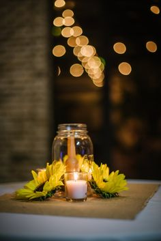 Simple centerpiece   An Eclectic Travel Inspired Wedding