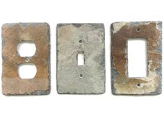 weathered roofing slate reclaimed and precision fashioned into light switch covers and outlet plates the