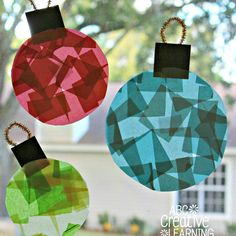 These magical Glass Stained Window Ornaments Kids Craft are easy to make and perfect for decorating your windows during Christmas and the holiday months!